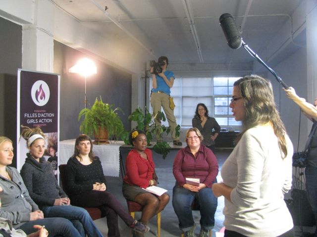 Elvira (right) coaches the participants in her organization's video.